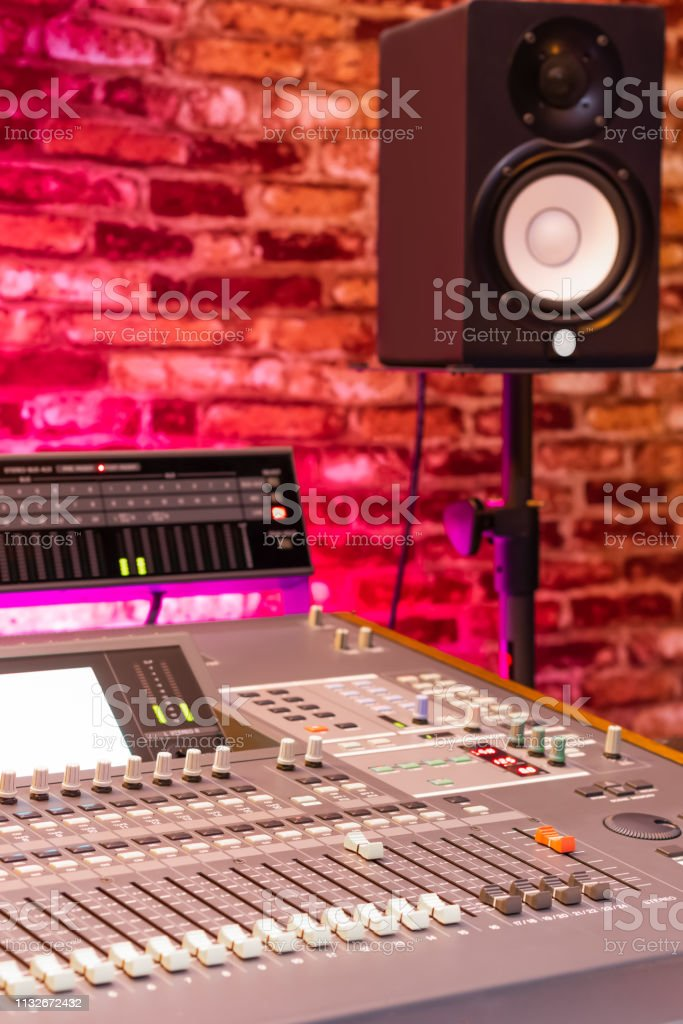 audio mixing console and monitor speaker in recording studio, copy...