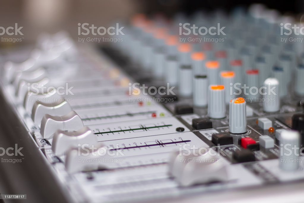 Audio mixing console. Knobs and controls on modern audio mixing...