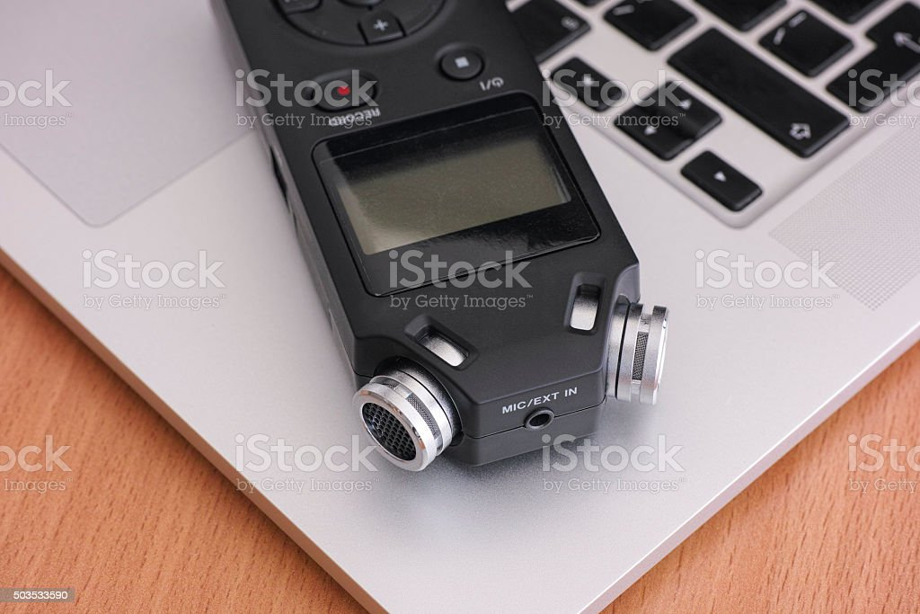 Audio recorder and laptop stock photo