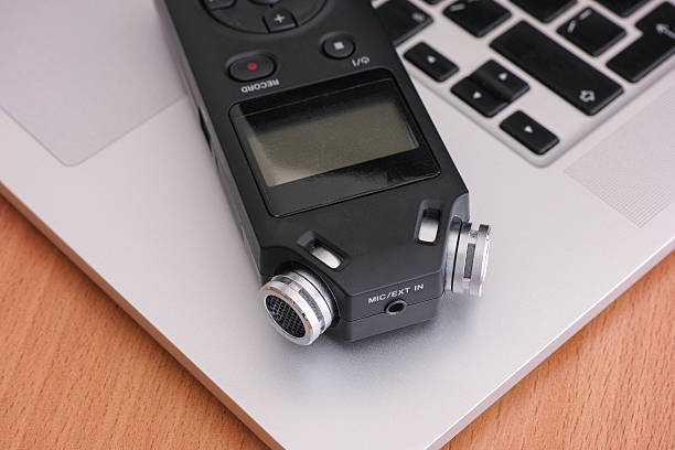 audio recorder and laptop - dictaphone stock pictures, royalty-free photos & images