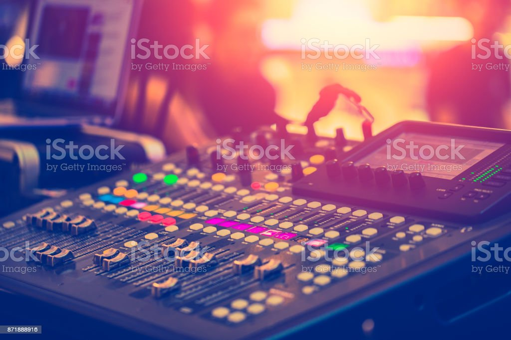 Audio Sound Mixer Adjusting Professional Sound Engineer Operator in Concert Hall stock photo