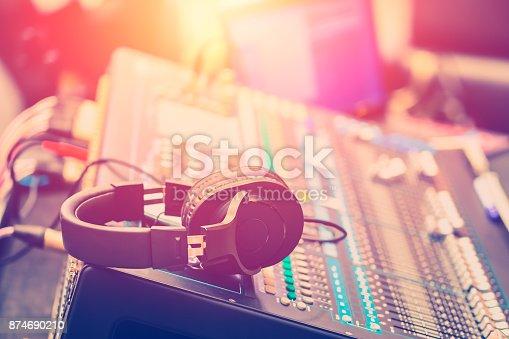 istock Audio Sound Mixer Adjusting Professional Sound Engineer Operator in Concert Hall 874690210