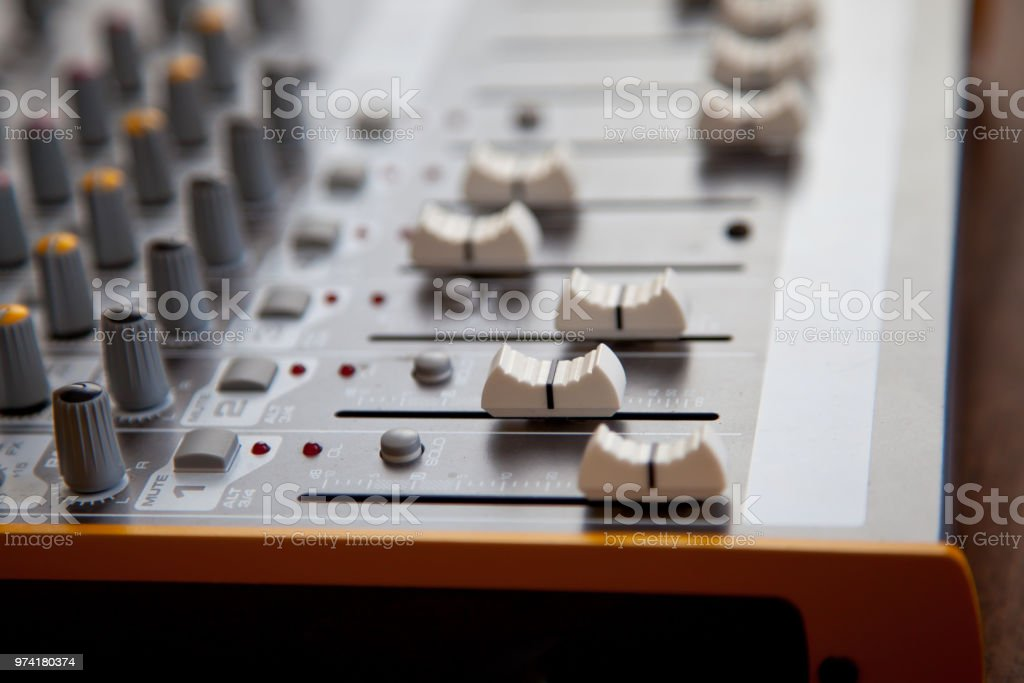 Audio studio sound mixer equalizer board sliders, faders and knobs,...