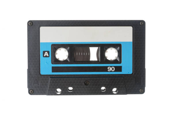 Audio tape cassette closeup on white background Audio tape cassette closeup on white background audio cassette stock pictures, royalty-free photos & images