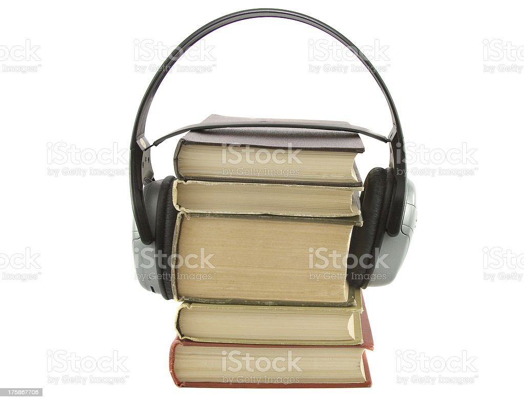 audiobook conception with headphones and books stock photo