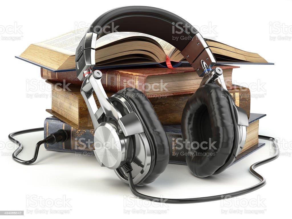 Audiobooks concept. Vintage books and headphones. stock photo