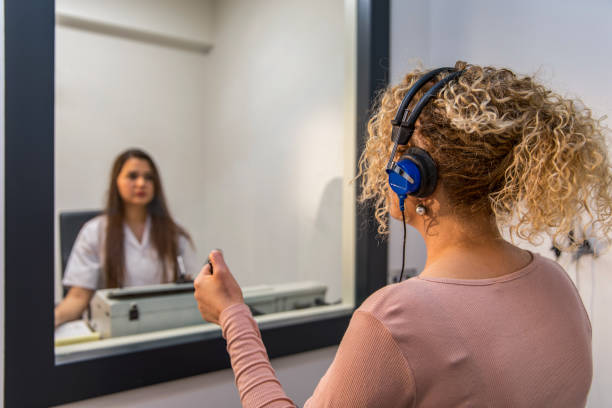 Audiometry exam - Hearing test - Audiologist - Audiometer - Ear test stock photo