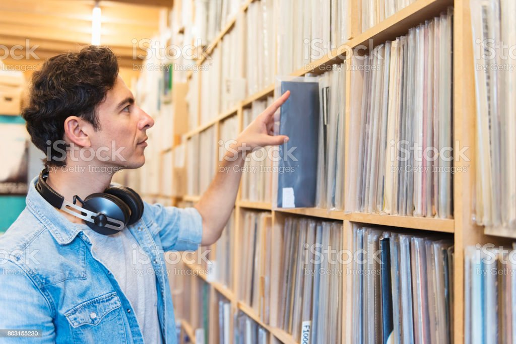 Audiophile Man At The Record Store Stock Photo & More Pictures of 20