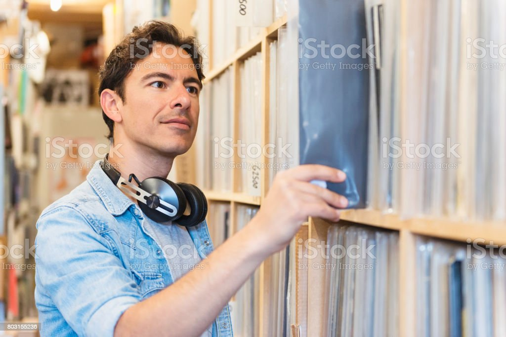 Audiophile Man Looking For A Record Stock Photo - Download Image Now
