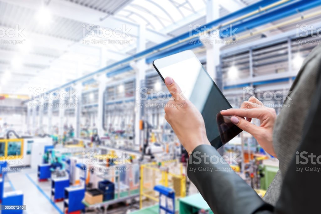 Audit & factory & digital tablet stock photo
