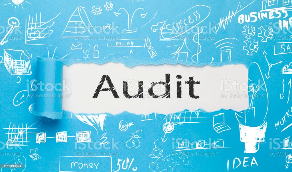 Audit text written paper on blue background stock photo