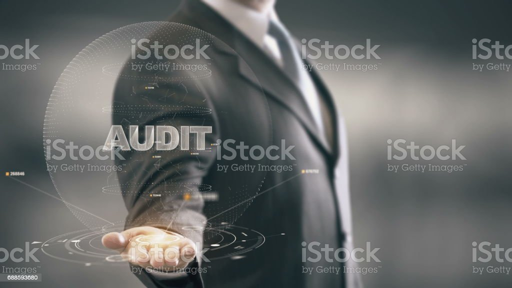 Audit with hologram businessman concept stock photo