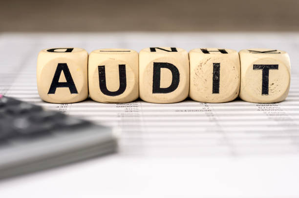 Audit word whith calculator and balance sheet stock photo