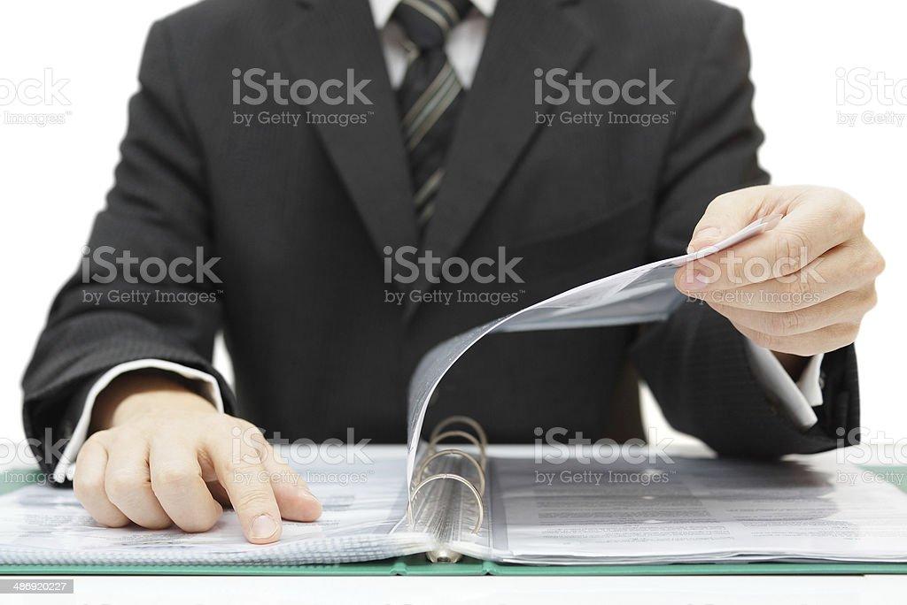auditor checking documentation stock photo