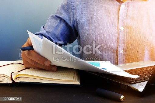 istock Auditor checking financial report. Paperwork in the office and audit. 1020597044