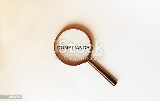 Auditor checking financial statement with magnifying glass. Audit Concept. top view.