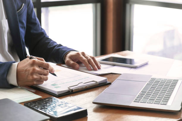 auditor or financial inspector working on business report stock photo
