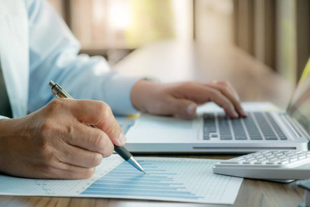 auditor or financial inspector working on business sales report. stock photo