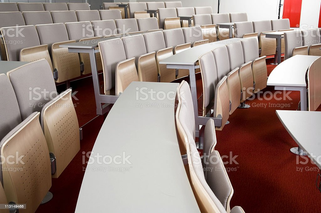 Empty seats of a modern auditorium, side view