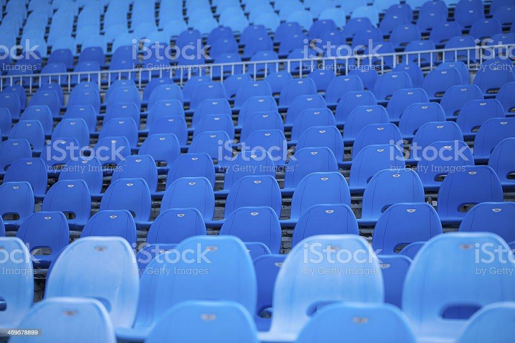 blue plastic chairs in the stadium