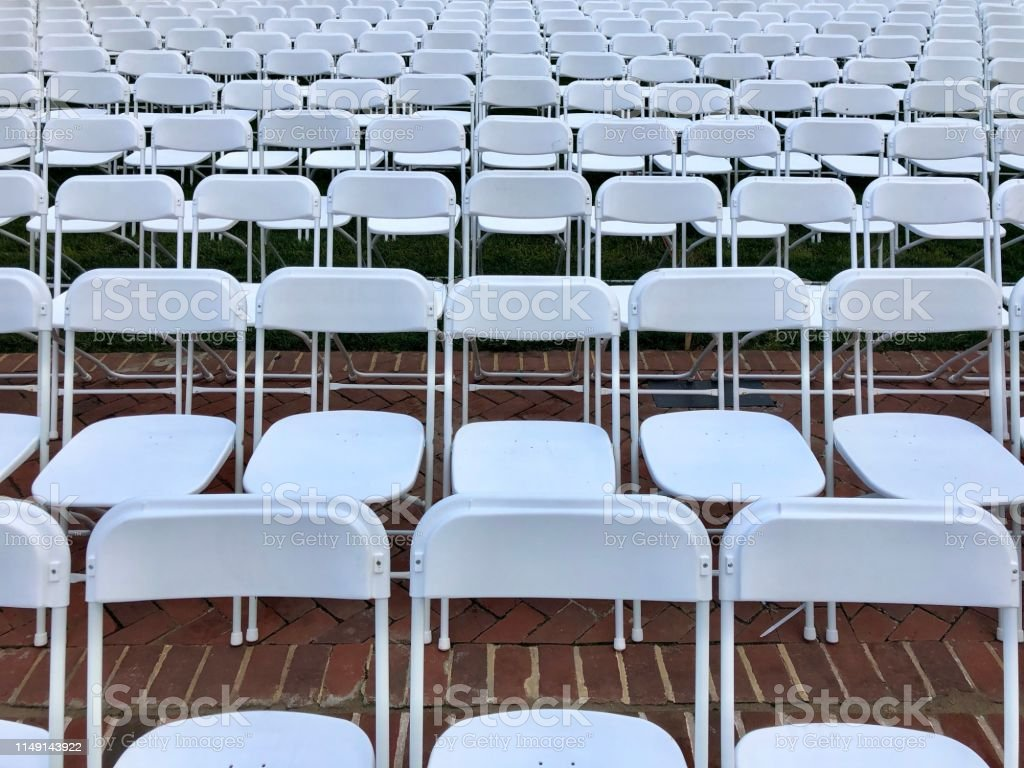 Rows of parallel chairs in preparation for a graduation ceremony.