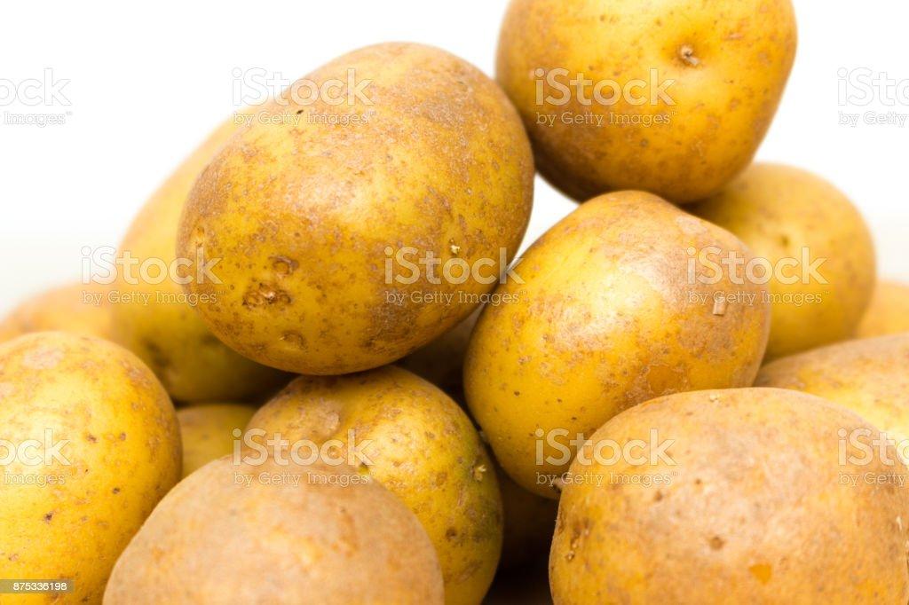 Aufgehäufte gelb orange Kartoffeln stock photo