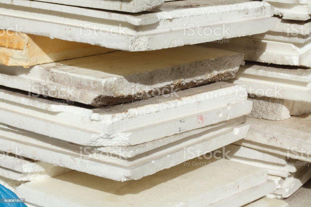 Aufgestapelte alte  Styroporplatten auf einer Baustelle stock photo