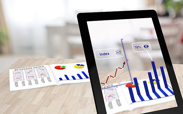 Augmented reality business magazine and tablet stock photo