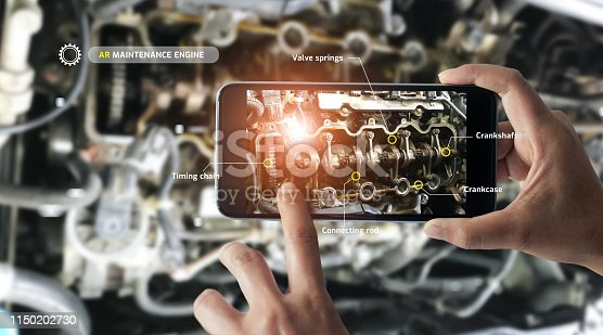 istock Augmented reality concept. AR. Industrial 4.0 , Hand of engineer holding mobile smart phone using virtual AR to check the work of electric machine on smart factory background. 1150202730