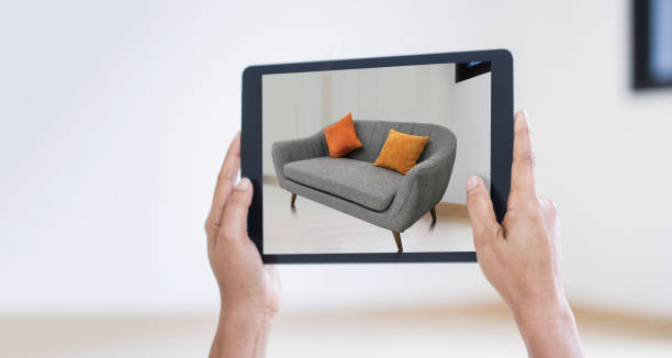 ar augmented reality. hand holding digital tablet, ar application, simulate sofa furniture and and interior design real room background, modern technology. - realtà aumentata foto e immagini stock
