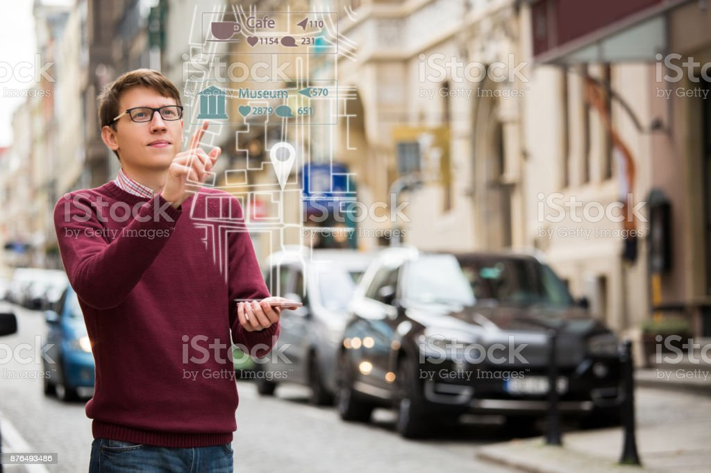 Augmented reality in marketing. Man with phone. stock photo