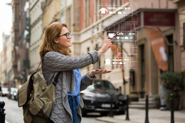 augmented reality in marketing. woman traveler with phone. - augmented reality stock photos and pictures