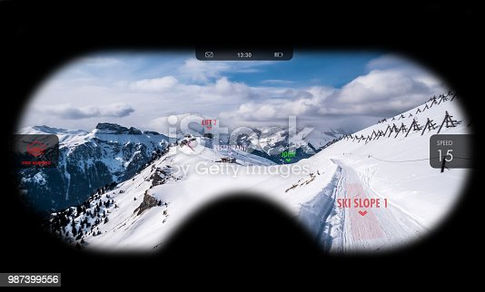 istock Augmented reality in ski goggles. Information about speed, places and slopes is displayed inside glasses. Concept of skiing in AR. 987399556