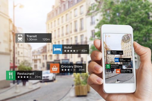 istock Augmented Reality information technology, hand, smartphone screen, street business, services 875335732