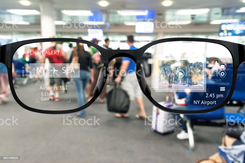 Augmented reality marketing and smart AR glasses technology concept. Customer using AR application to monitoring , check , alert  airline flight. Blur Airport background stock photo