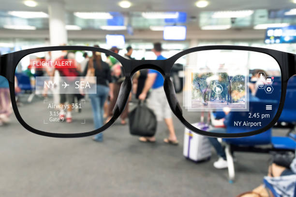 augmented reality marketing and smart ar glasses technology concept. customer using ar application to monitoring , check , alert  airline flight. blur airport background - augmented reality stock photos and pictures