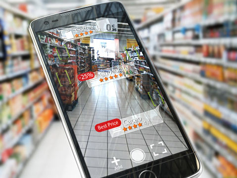 istock Augmented reality marketing application concept.  Mobile smart phone check relevant information about product in the supermarket. 1000151642