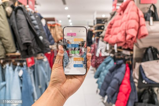 890476604 istock photo Augmented reality marketing . Hand holding smart phone use AR application to check information 1196029568