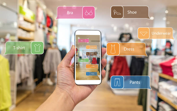Augmented reality marketing . Hand holding smart phone use AR application to check information stock photo