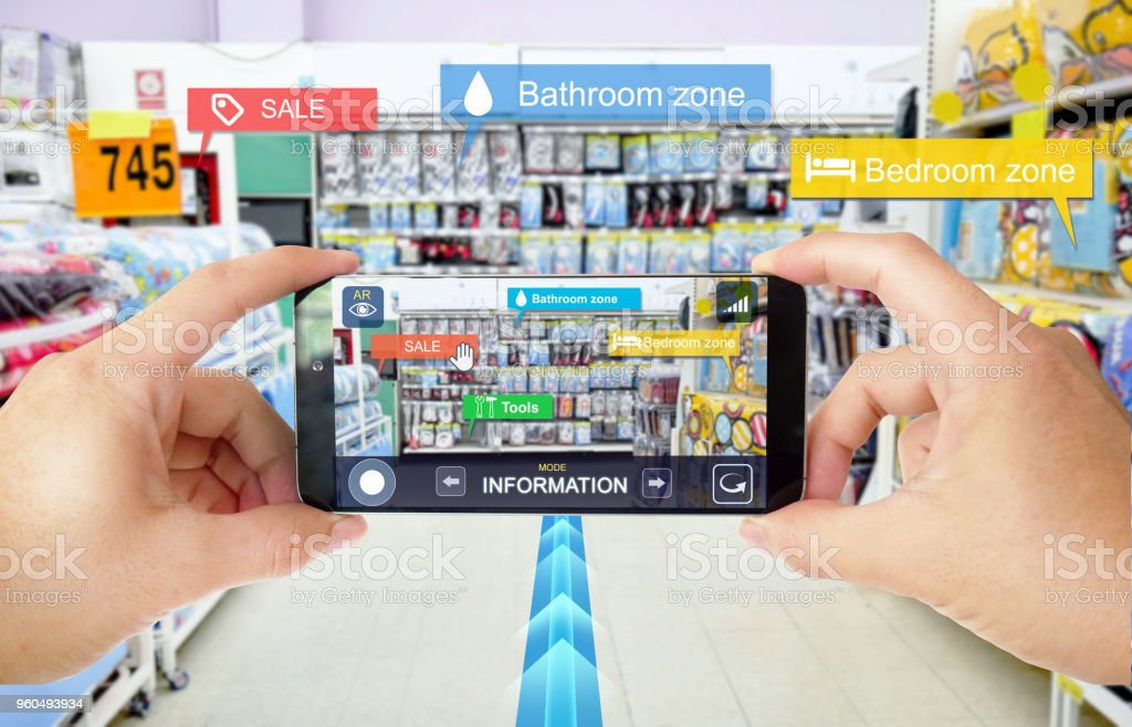 Augmented reality marketing in Department store. Hand holding smart phone use AR application to navigator, check information and promotion. stock photo
