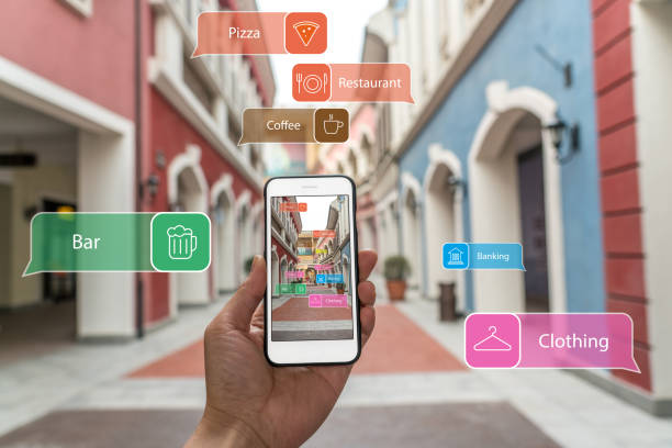 augmented reality marketing street. hand holding smart phone use ar application to check information - augmented reality stock photos and pictures