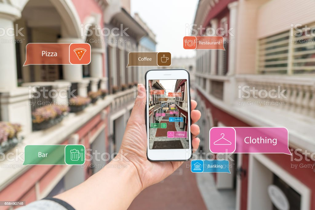 Augmented reality marketing street. Hand holding smart phone use AR application to check information stock photo