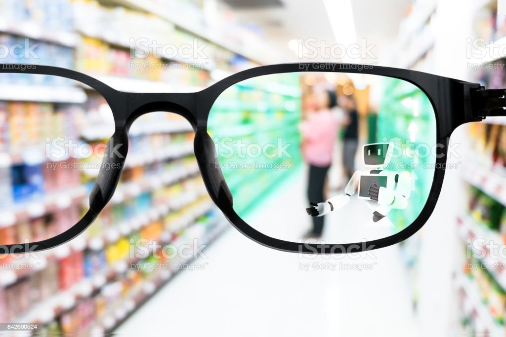 Augmented reality , smart AR glasses technology , crm marketing concept. Customer using AR application robot adviser to help navigation and recommend goods in supermarket retail department store. stock photo