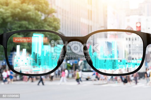istock Augmented reality , smart AR glasses technology , smart city , internet of things concept. Customer using AR application see digital 3d rendering building with blur city background. 831559590