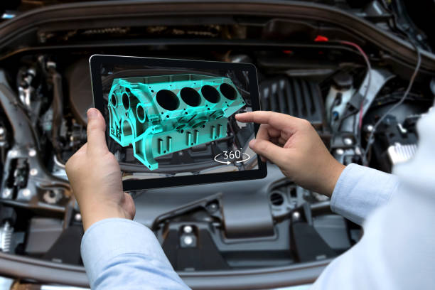 Augmented reality technology and engineering marketing concept. Hand holding tablet with AR service application to rotate 3d rendering of energy block 360 degrees with blur car engine room background stock photo