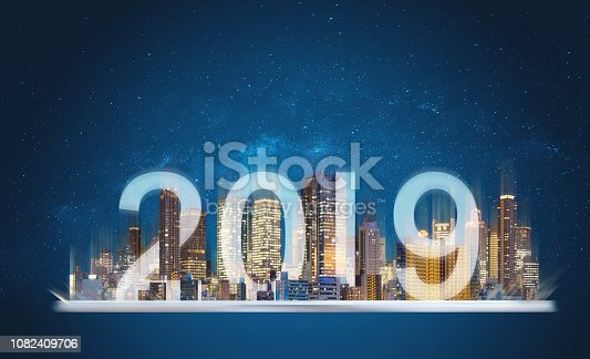 1082409706 istock photo 2019 augmented reality technology. Building hologram on digital tablet with new year 2019 1082409706