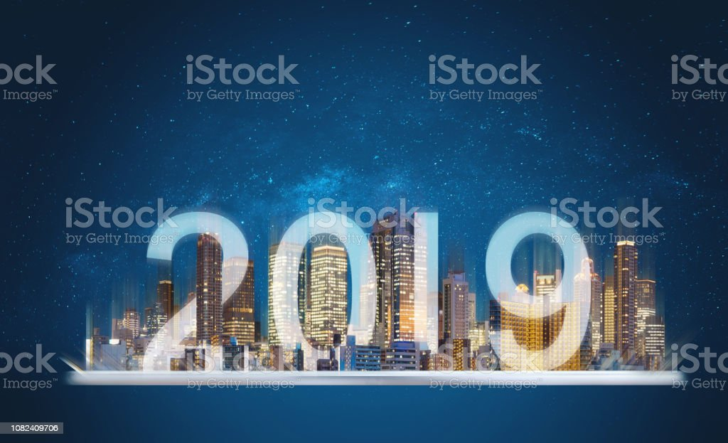 2019 augmented reality technology. Building hologram on digital tablet with new year 2019 stock photo