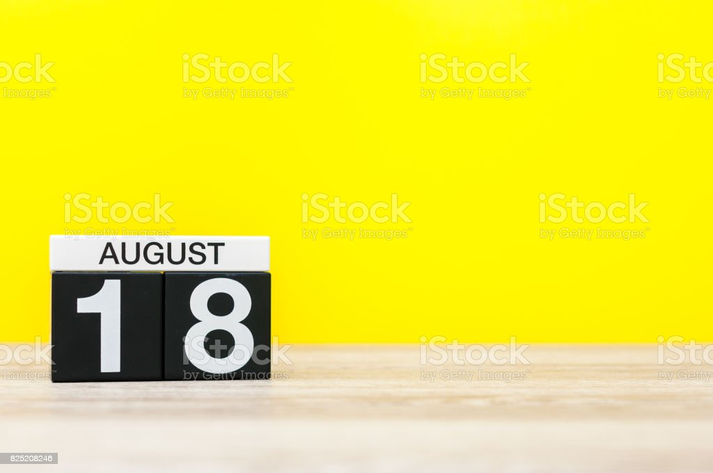August 18th. Image of august 18, calendar on yellow background with empty space for text. Summer time stock photo