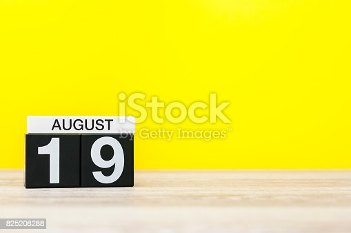 istock August 19th. Image of august 19, calendar on yellow background with empty space for text. Summer time 825208288