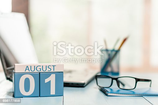 istock August 1st. Day of the month 1 wooden color calendar on business workplace background. Summer time. Empty space for text 698177858